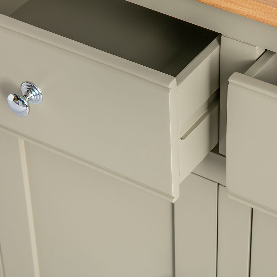 Close up of the pinted green wooden drawer runners on the Chichester Green Small Sideboard