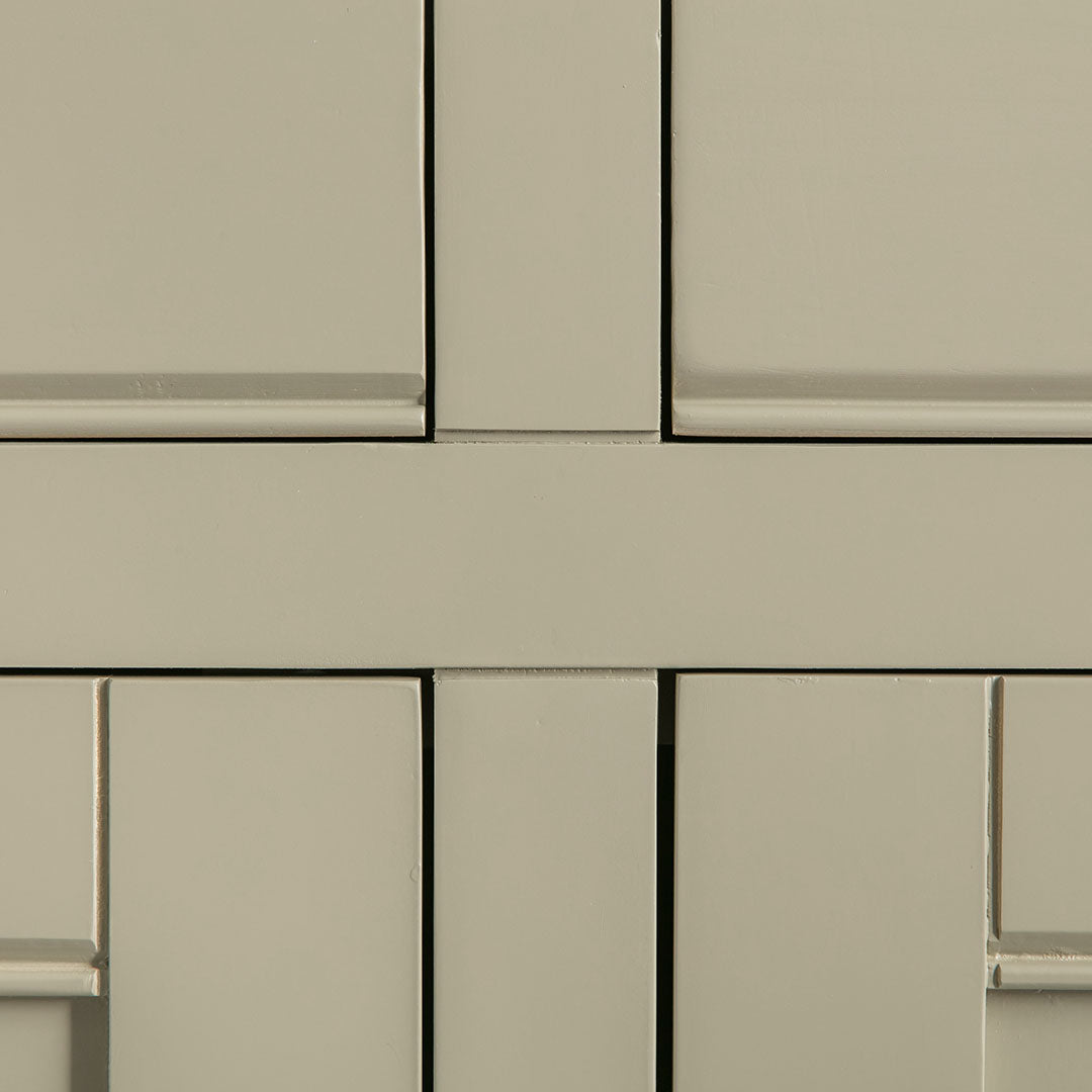 Close up of the painted green solid wood frame on the Chichester Green Small Sideboard