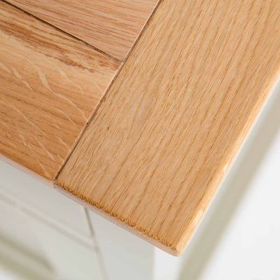 Close up of the oak top corner of the Chichester Ledum Green Small Sideboard