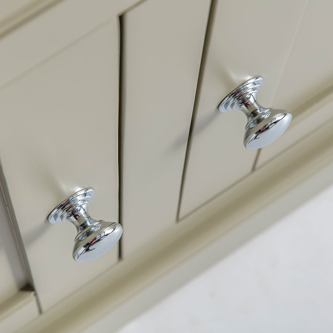 Close up of the round metal door handles on the Chichester Green Small Sideboard