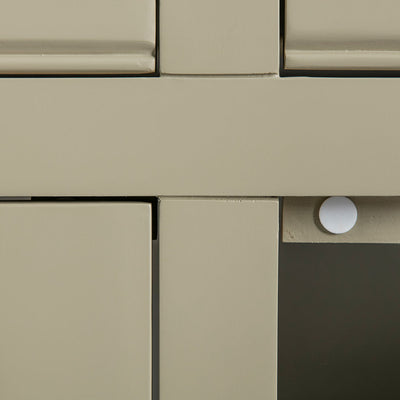 Close up of the green solid wood frame and door stopper on the Chichester Ledum Green Extra Large Sideboard