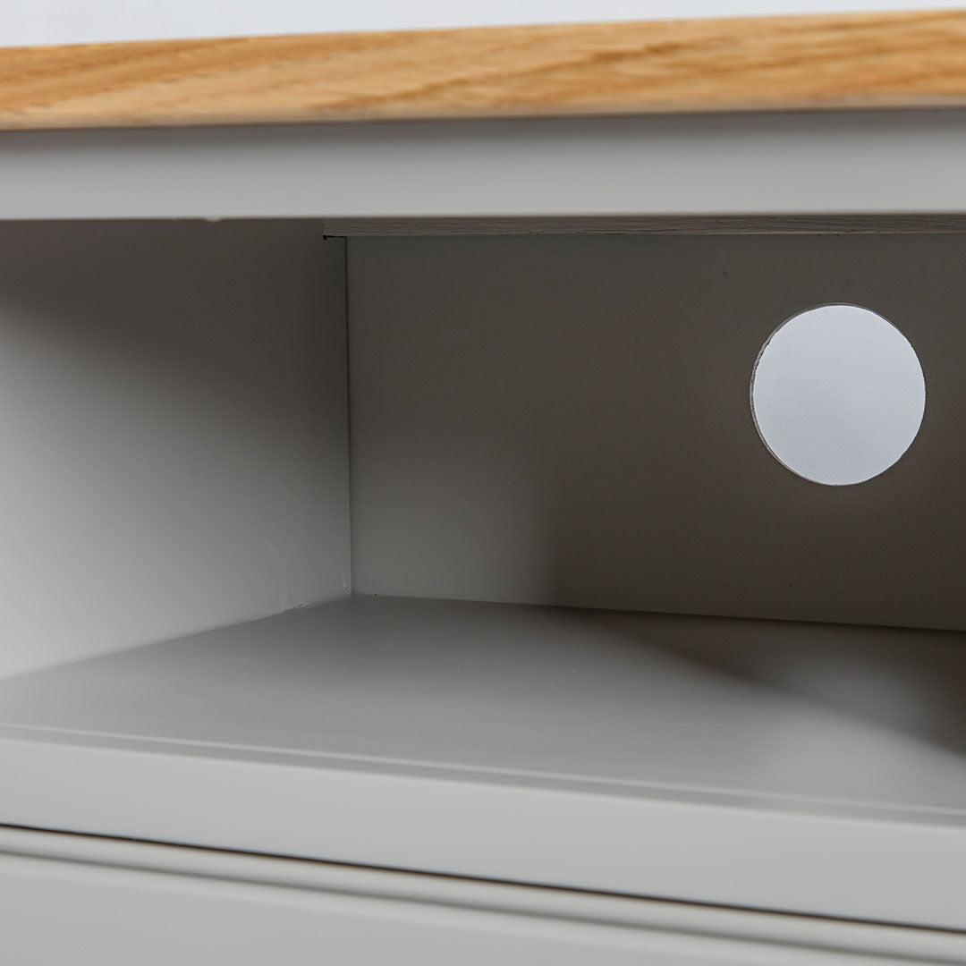Close up of the open shelf on the Chichester Grey Small TV Stand