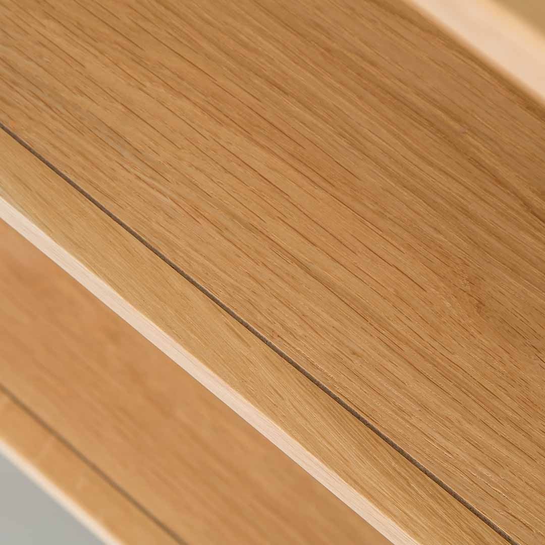 Close up of the oak veneer wood grain on the Chichester Chester Grey Low Bookcase