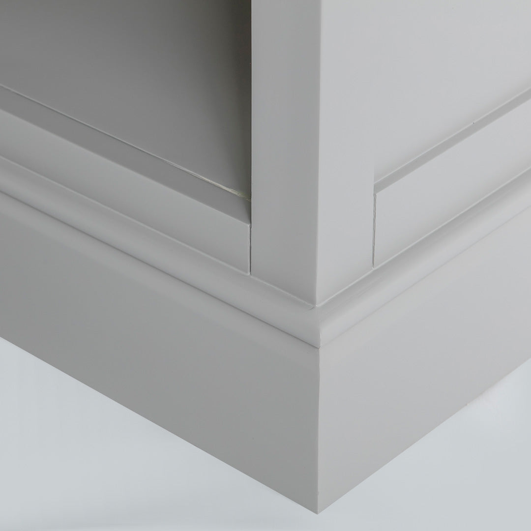 Close up of the grey painted plinth base on the Chichester Chester Grey Low Bookcase