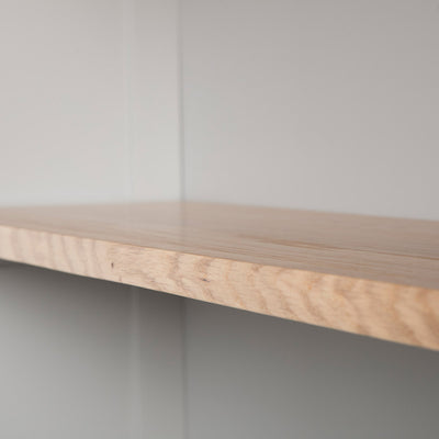 Close up of the oak fixed shelf edge on the Chichester Chester Grey Low Bookcase