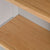 Close up of the oak veneer shelf on the Chichester Chester Grey Low Bookcase