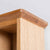 close up of the tapered top on the Light Oak Single DVD Tower