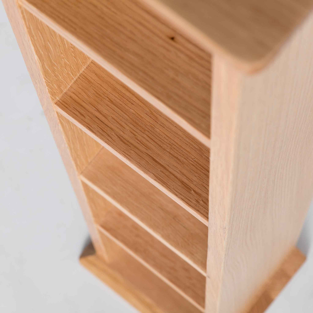 close up of wooden storage shelves on the Light Oak Single DVD Tower