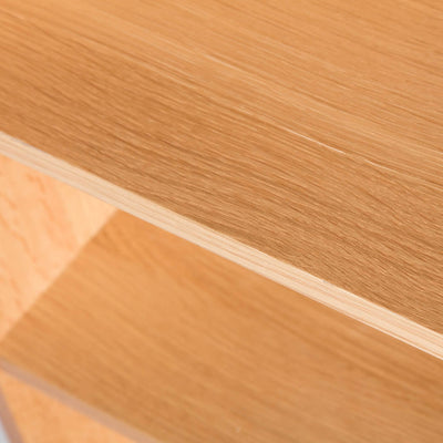 Close up of wooden shelf panel on the Light Oak Triple CD Tower