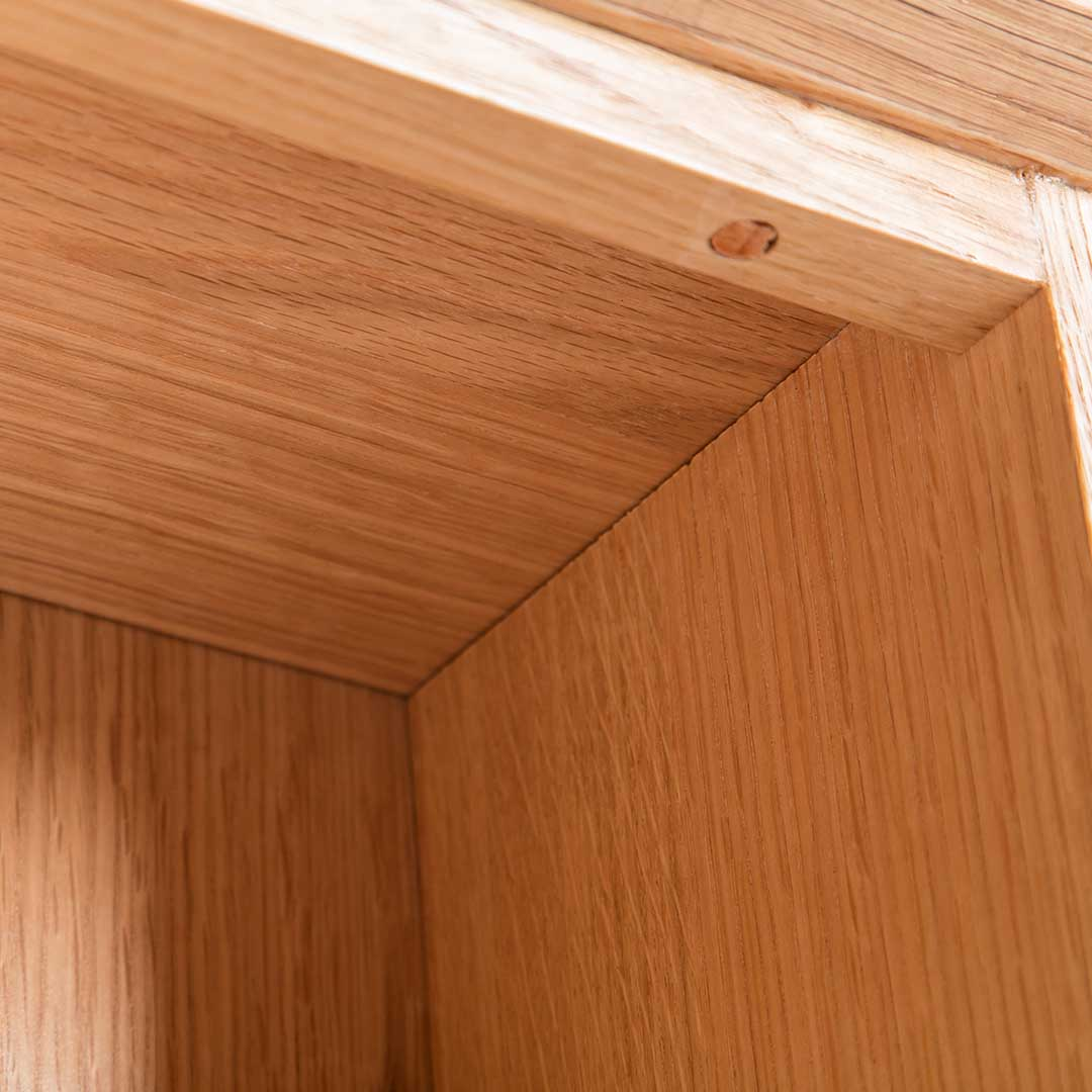 Close up of the upper corner on the Light Oak Triple CD Tower