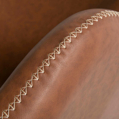 Bryce Brown Faux Leather Rocking Chair - Close up of arm stitching