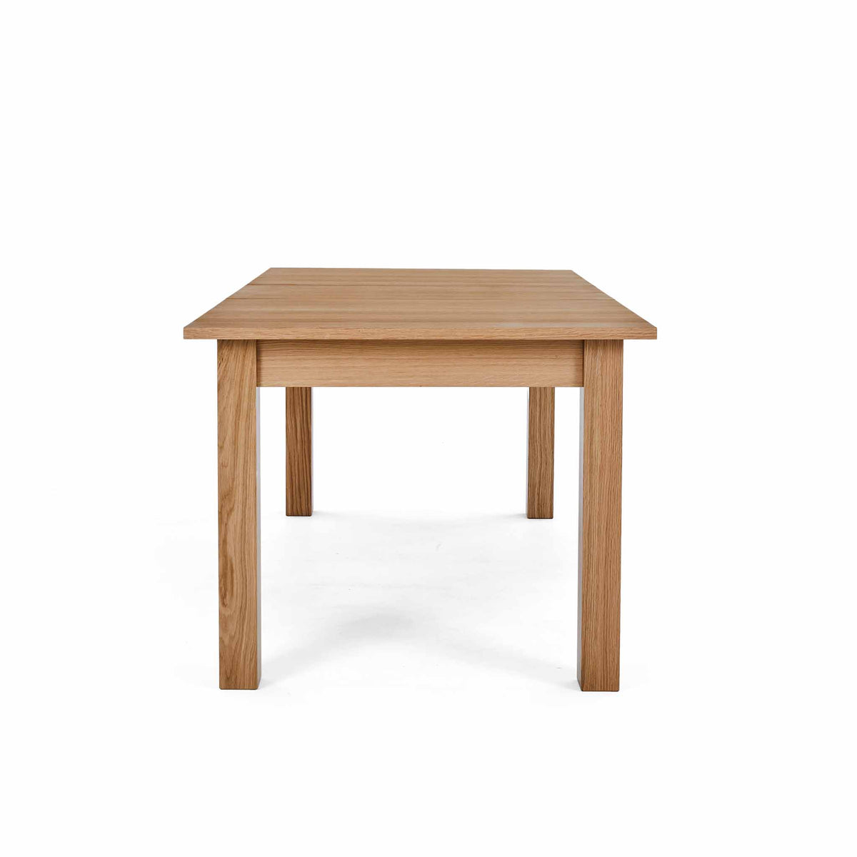 End view of the Falmouth Oak Large Extending Table by Roseland Furniture