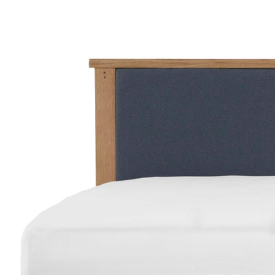 close up of upholstered fabric headboard on the Broadway Bed Frame
