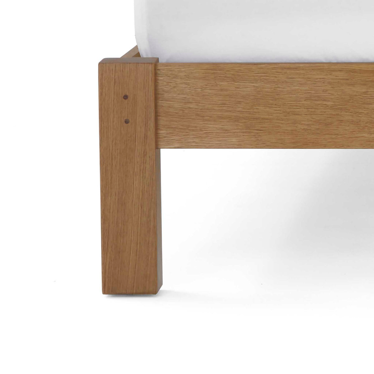 close up of solid wood frame leg on the Broadway Upholstered Bed Frame