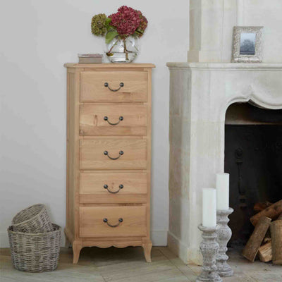 Lifestyle image of the Harrogate Oak French Style Tallboy Chest from Roseland Furniture