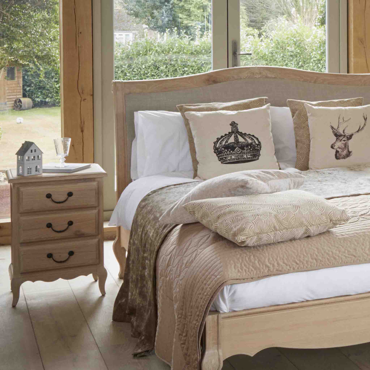 Lifestyle bedroom image of the Harrogate Oak French Style Bedside Table