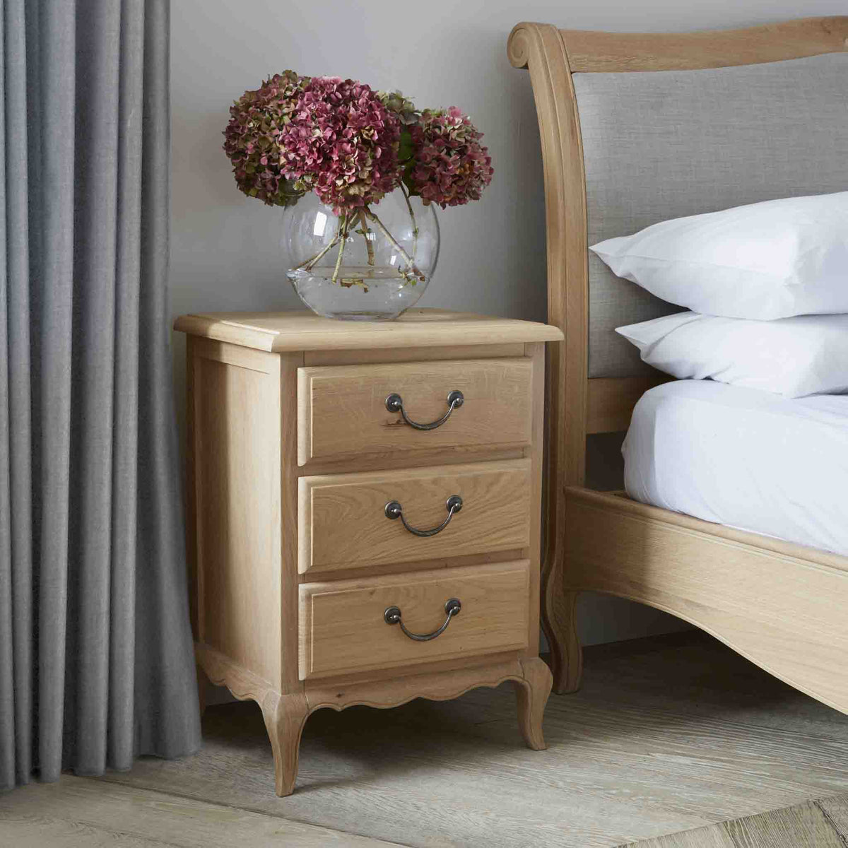 Lifestyle image of the Harrogate Oak French Style Bedside Table