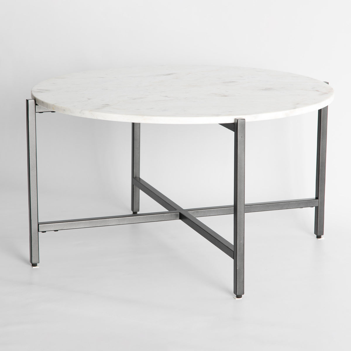 Side view of the Kandla White Round Marble Coffee Table with Grey Base