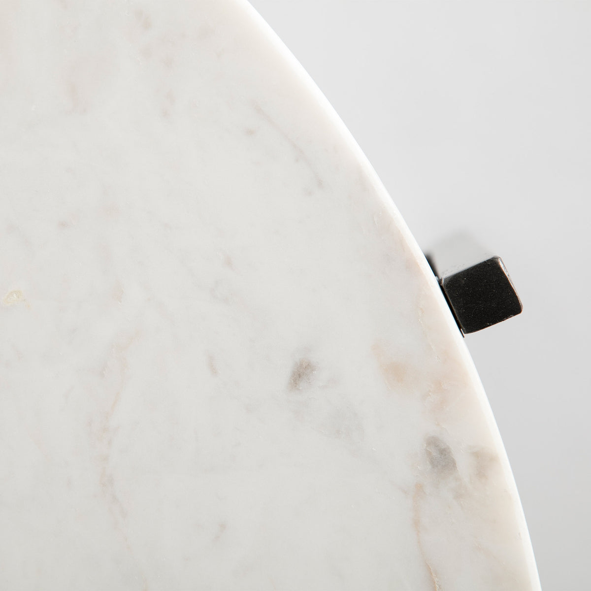 Top view of the curved marble top edge on the Kandla White Round Marble Coffee Table with Grey Base