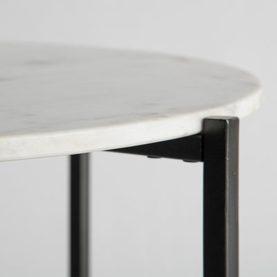 Side view of the marble table edge on the Kandla White Round Marble Coffee Table with Grey Base