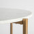 Side view of the curved marble edge on the Kandla White Round Marble Coffee Table with Gold Base