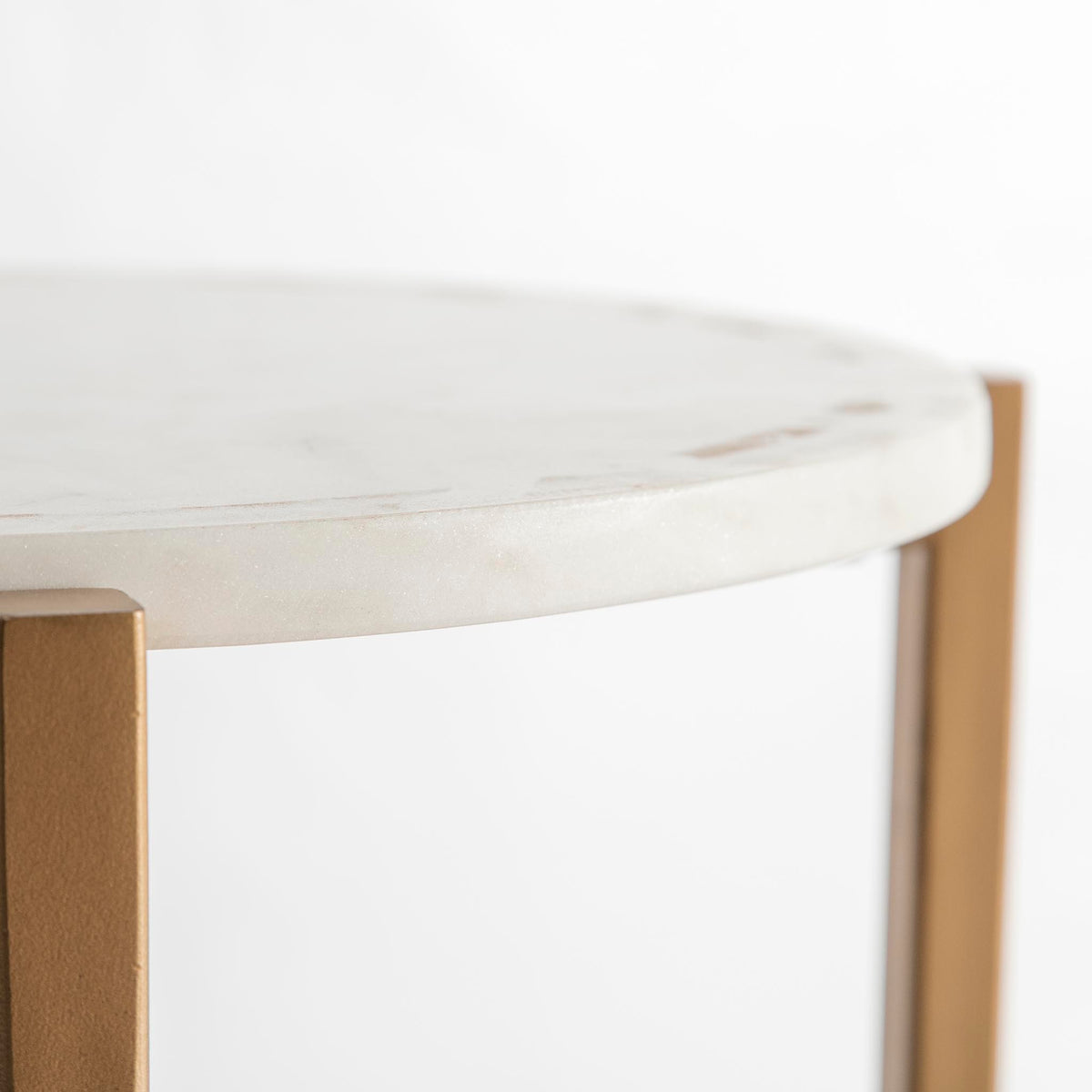 Kandla White Round Side Table with Gold Base - Close up of the marble tabletop edge