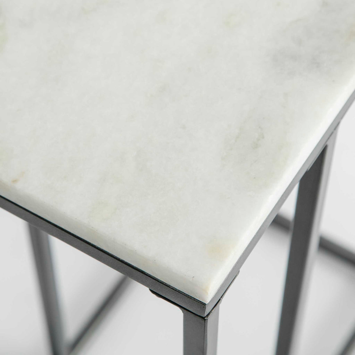 Close up of the white marble top corner on the Kandla White Marble Side Table with Grey Base
