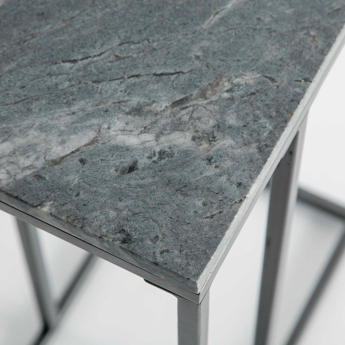 Close up of the natural marble grains on the Kandla Grey Marble Side Table with Grey Base