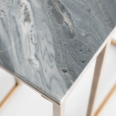 Close up of the natural marble grains for the natural marble on the Kandla Grey Marble Side Table with Golden Base
