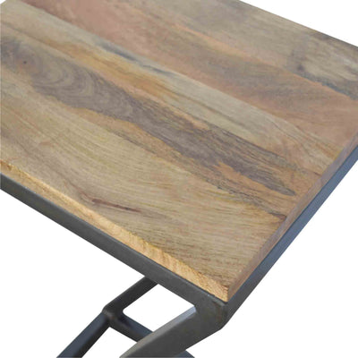 Close up of mango wood table top on The Artisan Industrial Z shaped Side Table