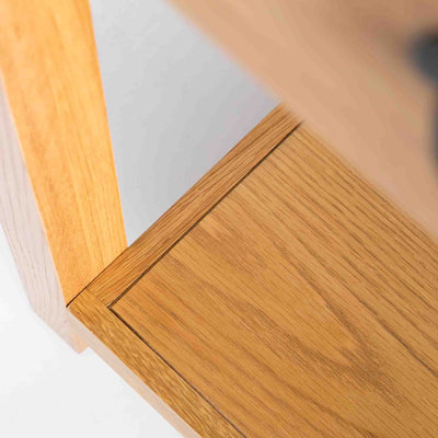 close up of lower shelf on the Roseland Oak Console Table