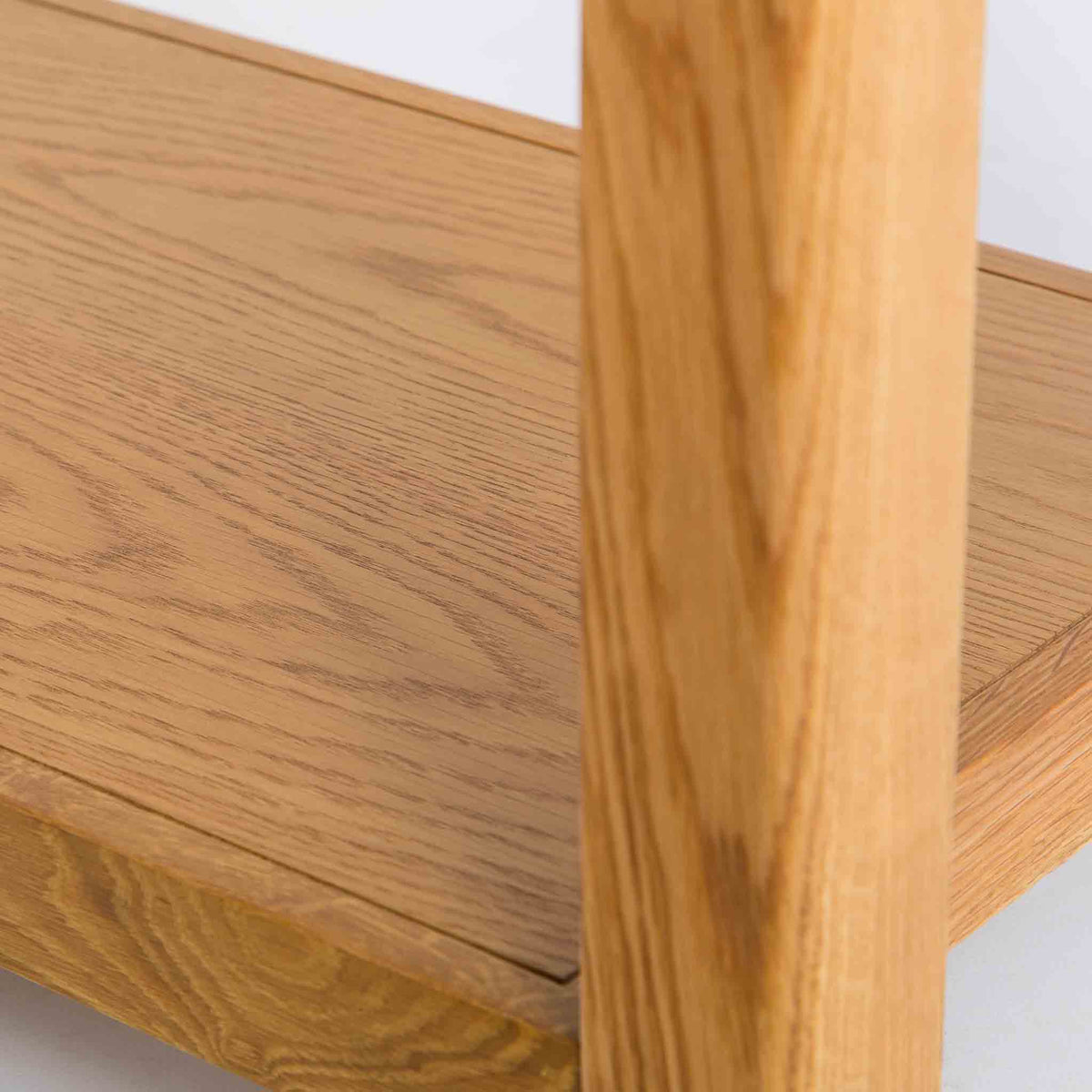 close up of wooden shelf on the Roseland Oak Console Table