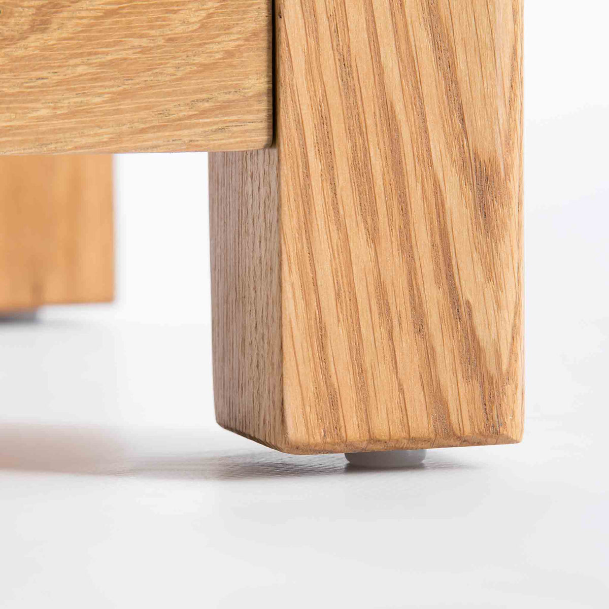 close up of solid wood leg on the Roseland Oak Console Table