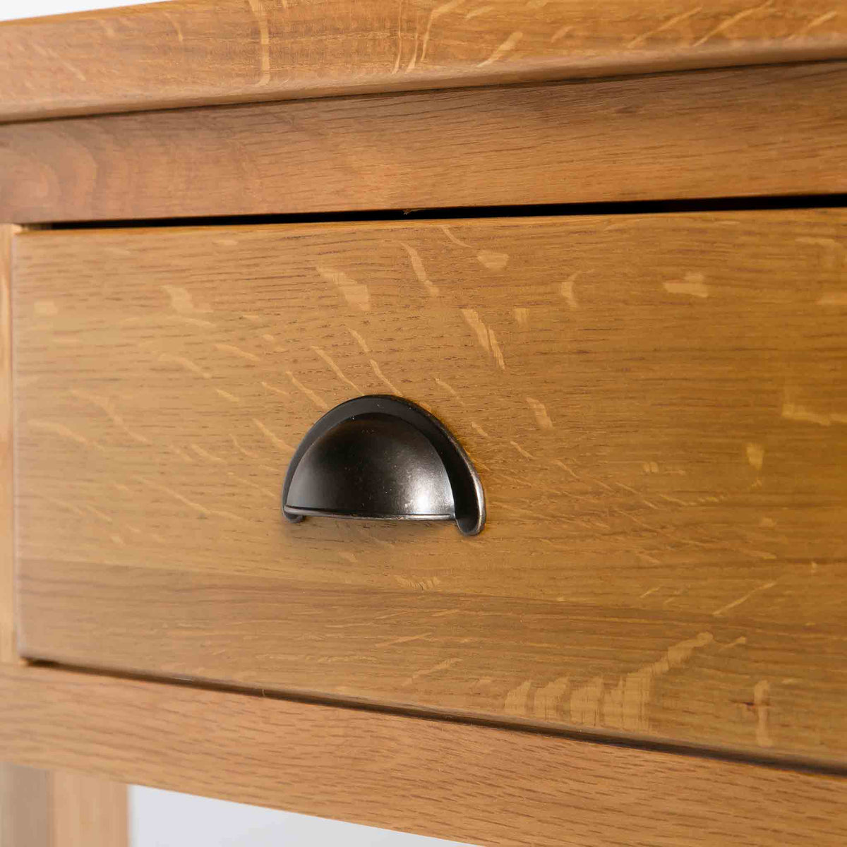 close up of the brass metal drawer handle on the Roseland Oak Console Table