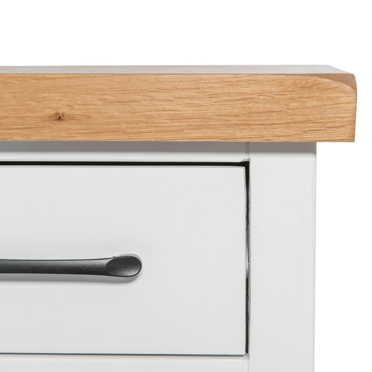 close up of leg on the Chatsworth White Bedside Table with 3 Drawers from Roseland Furniture