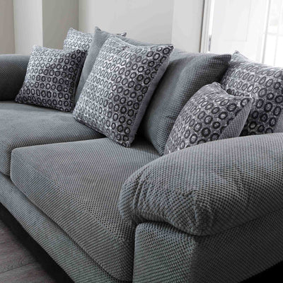 close up of the scatter cushions on the Ameba Charcoal 3 Seater Fabric & Faux Leather Sofa