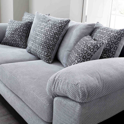 close up of the scatter cushions on the Ameba Silver 3 Seater Fabric & Faux Leather Sofa