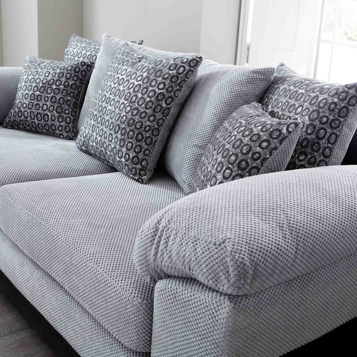 close up of the scatter cushions on the Ameba Silver Fabric & Faux Leather Corner Chaise Sofa