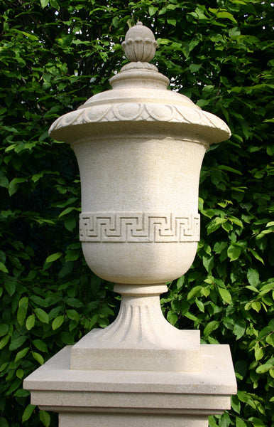Large garden urn carved in solid sandstone