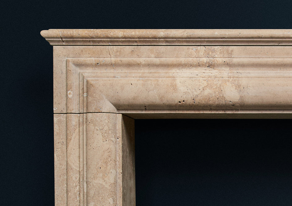 17th Century French fireplace carved in golden travertine.