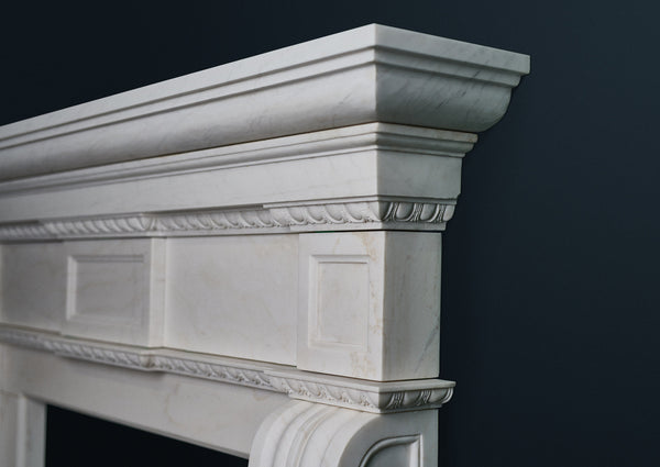 Colonial fireplace in veined solid white marble