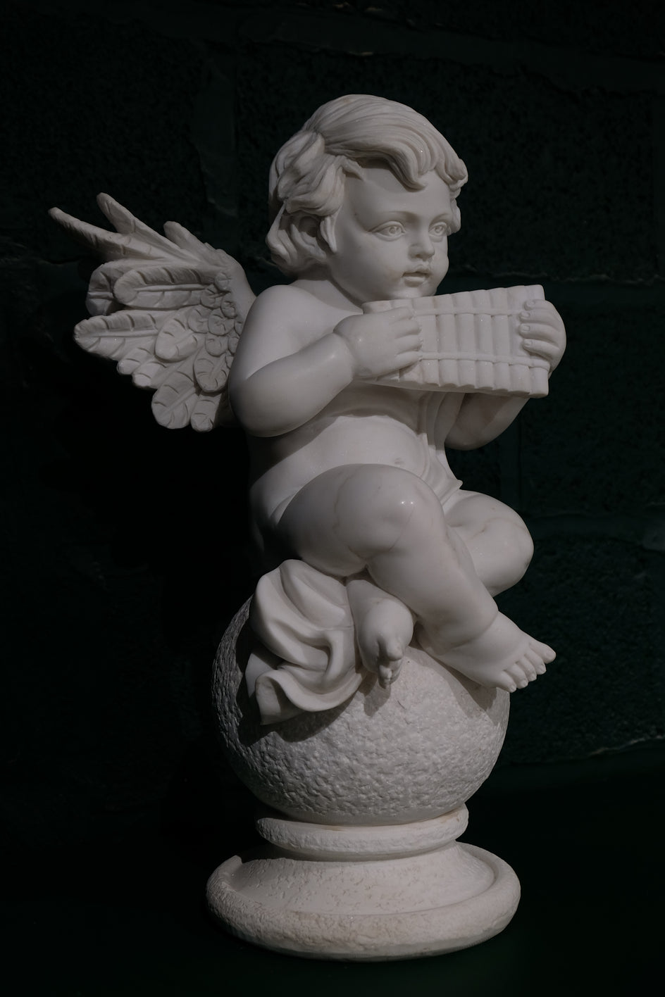 Cherub with wind instrument