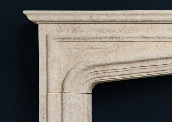 Elizabethan fire surround in aged limestone