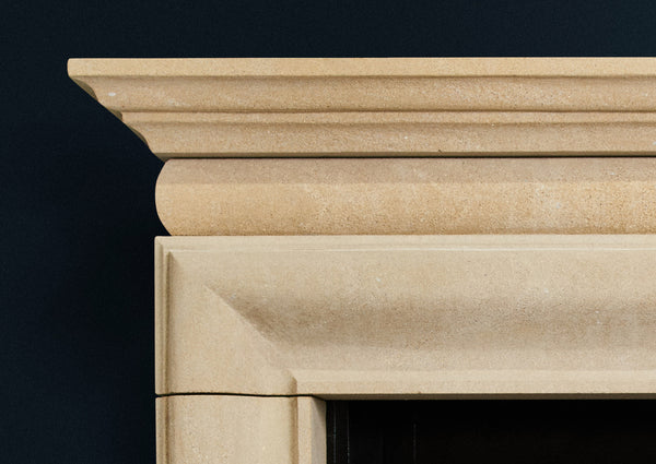 English Bolection fire surround in sandstone
