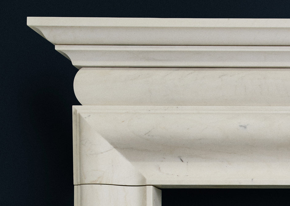 English Bolection fire surround in veined white marble