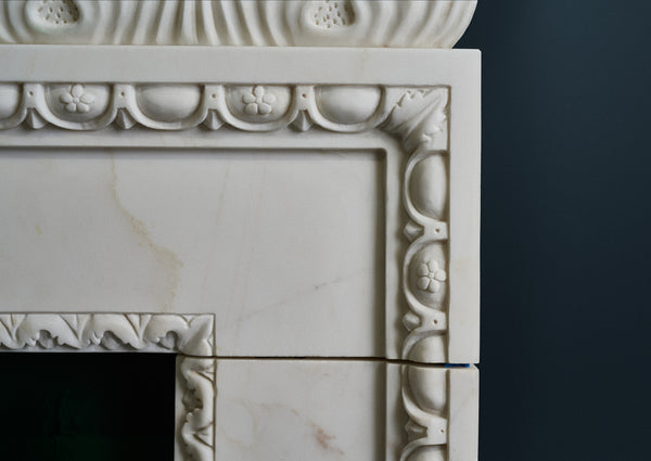Kent Acanthus fire surround in veined white marble