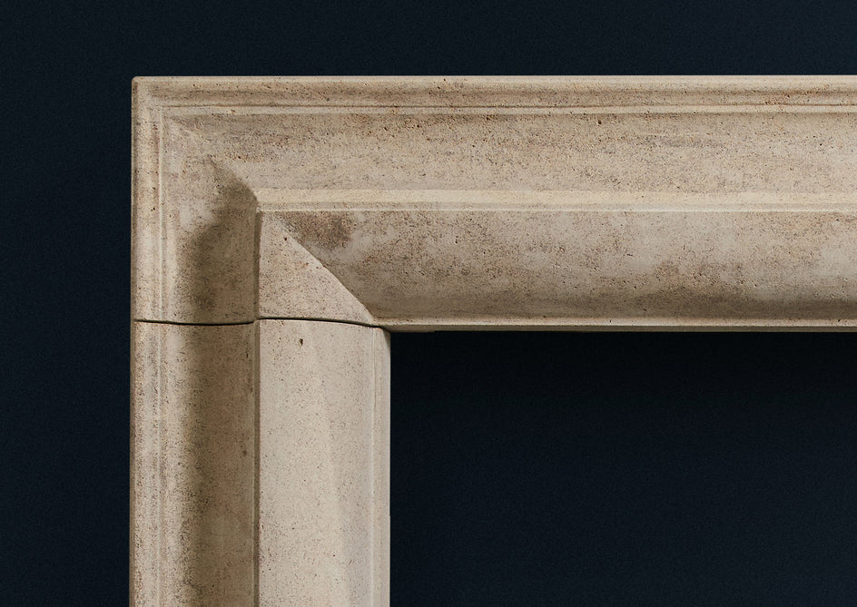 Corner detail of Straight Bolection limestone fireplace