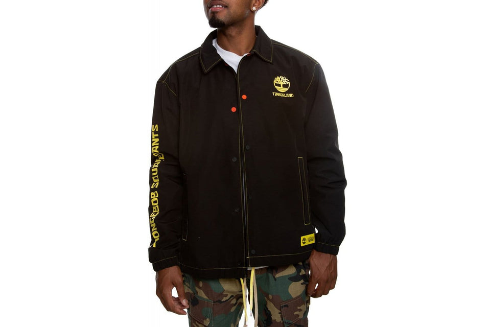 Mens coach jacket in black from the Timberland x Spongebob Squarepants collection. Spongebob graphics in yellow on sleeve and back.