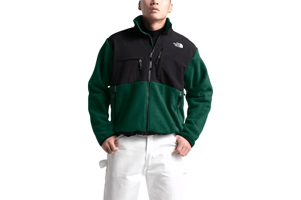 The North Face's warm, recycled-fleece jacket has the original 1995 Denali silhouette in night green, front view.