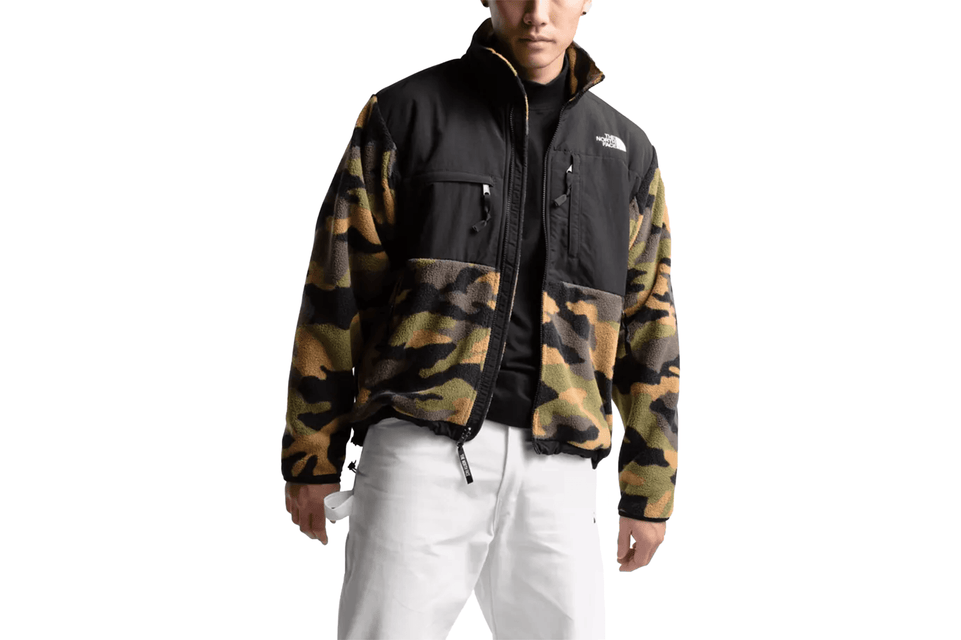 The North Face's warm, recycled-fleece jacket has the original 1995 Denali silhouette in camo. Front view.